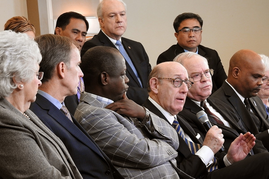 Kenneth Feinberg holding microphone speaks during a livestreamed panel discussion in Tampa Fla.jpg